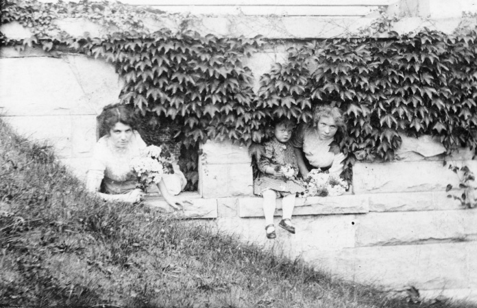 black and white photo of children in the garden