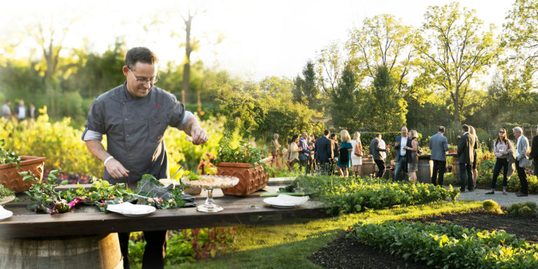 chef in the garden with guests