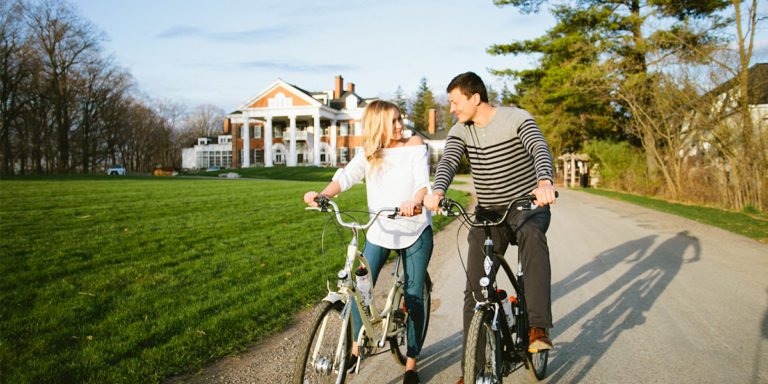 couple on bikes in front of Langdon Hall