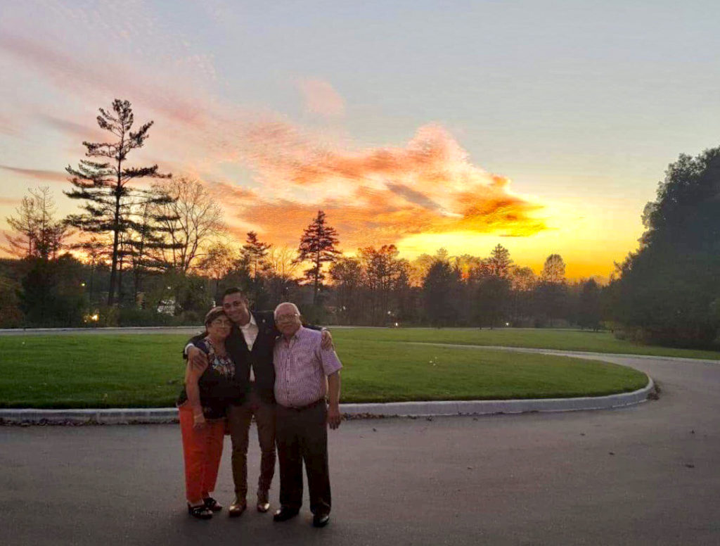 family in front of sunset