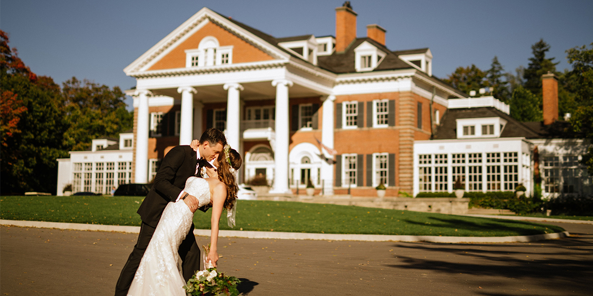 bride and groom in front of Langdon Hall