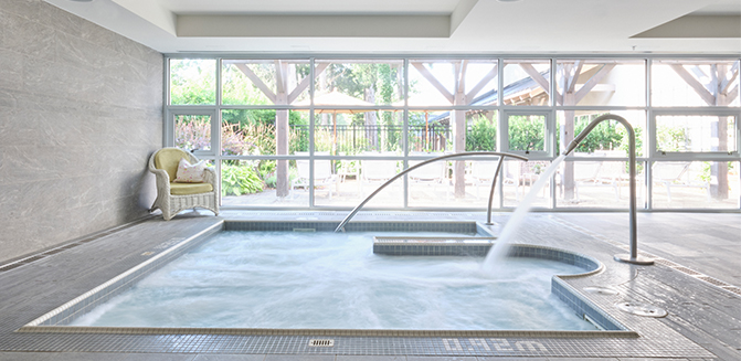 Spa whirlpool with view of outdoor terrace loungers