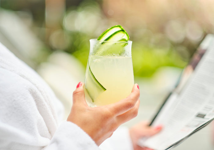 close up on a summer cocktail beverage with cucumber