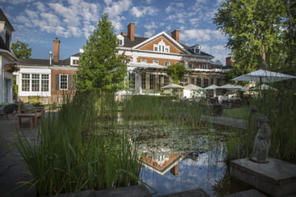 view of the back of Langdon Hall from the lily pond