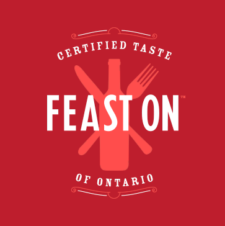Feast on logo - red background with fork, knife and bottle