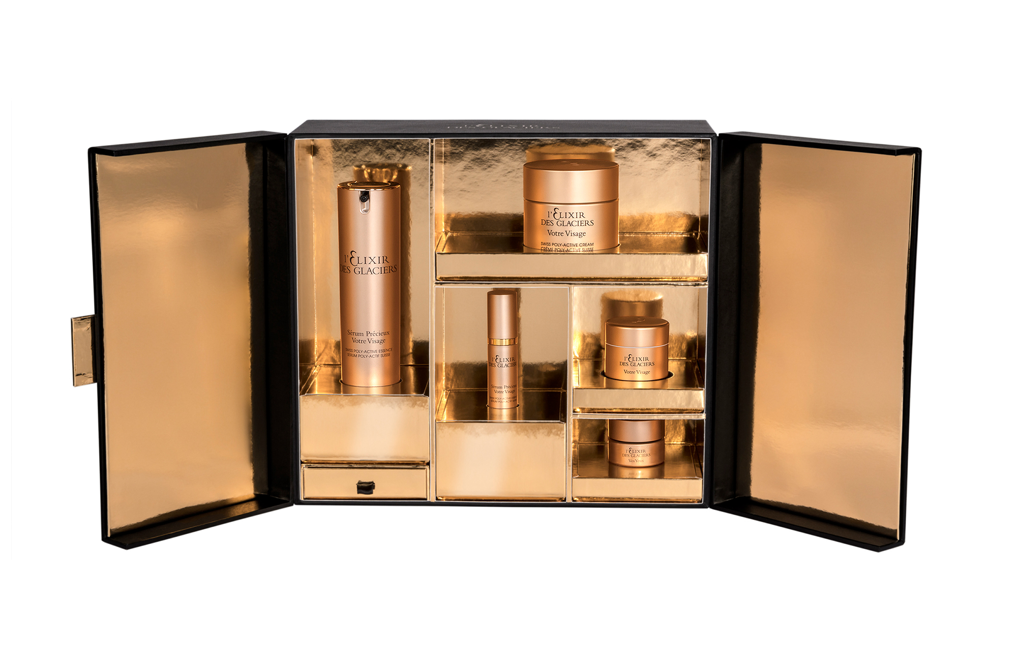 excellence of elixir gold and black boxed kit 5 bottled valmont products
