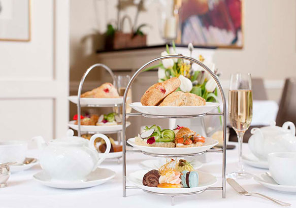 Afternoon tea tier with scones and other edible treats