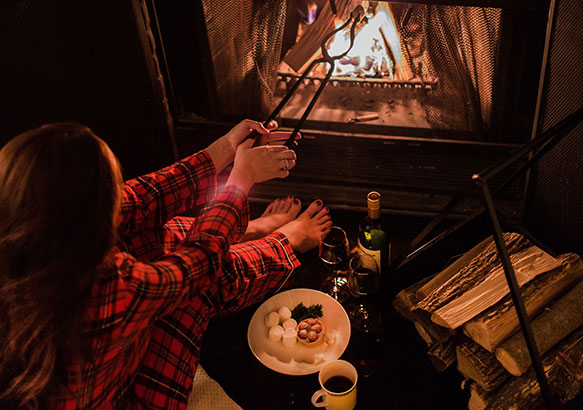 Roasting marshmallows in plaid pajamas