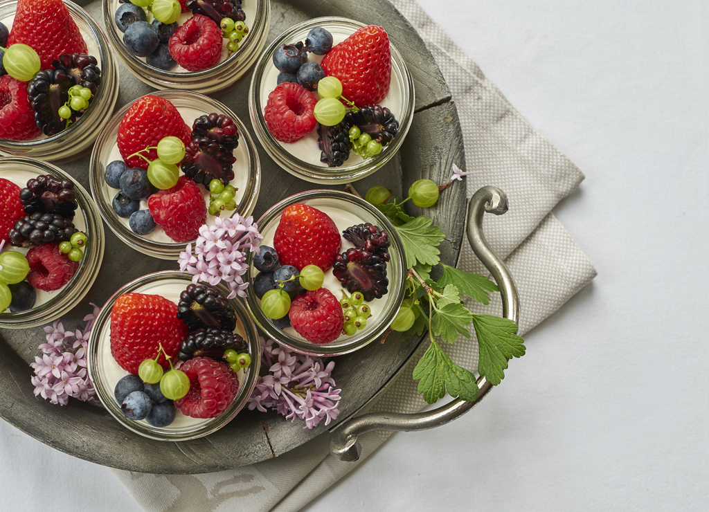 fruit parfaits in mason jars on a serving tray