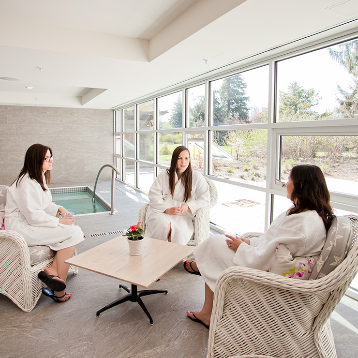 Three ladies spitting and chatting in the spa whirlpool lounge
