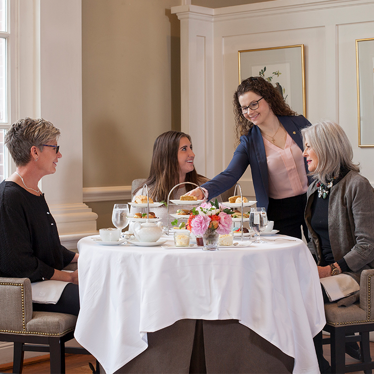 Three ladies enjoying afternoon tea