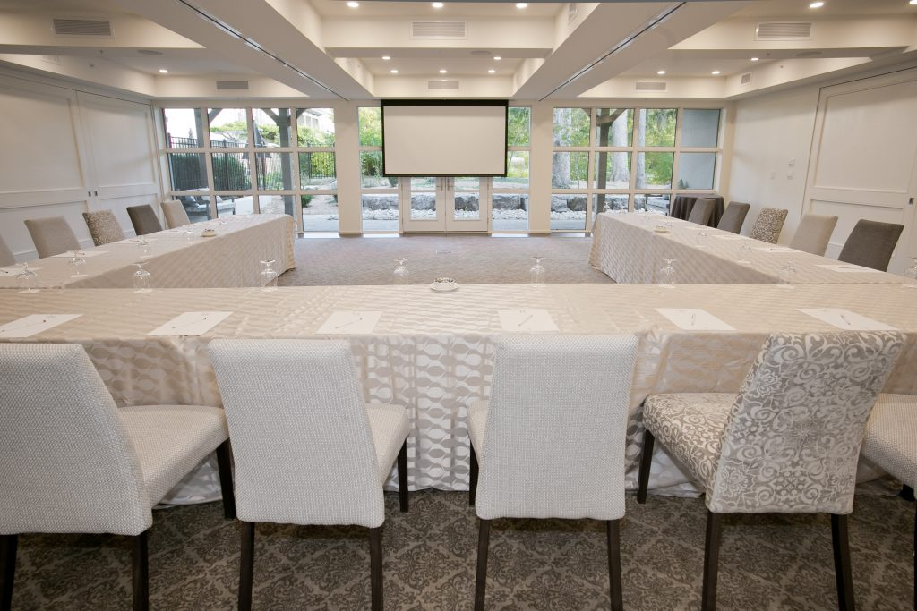 meeting room with table, chairs and screen