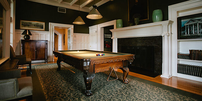 Wilks Bar billiards pool table with fireplace and lounge seating